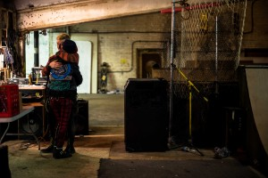 Jaime and Thao embrace during the end of a punk night at the Warehouse. A relatively new couple both still prefer to only show affection after everyone leaves.